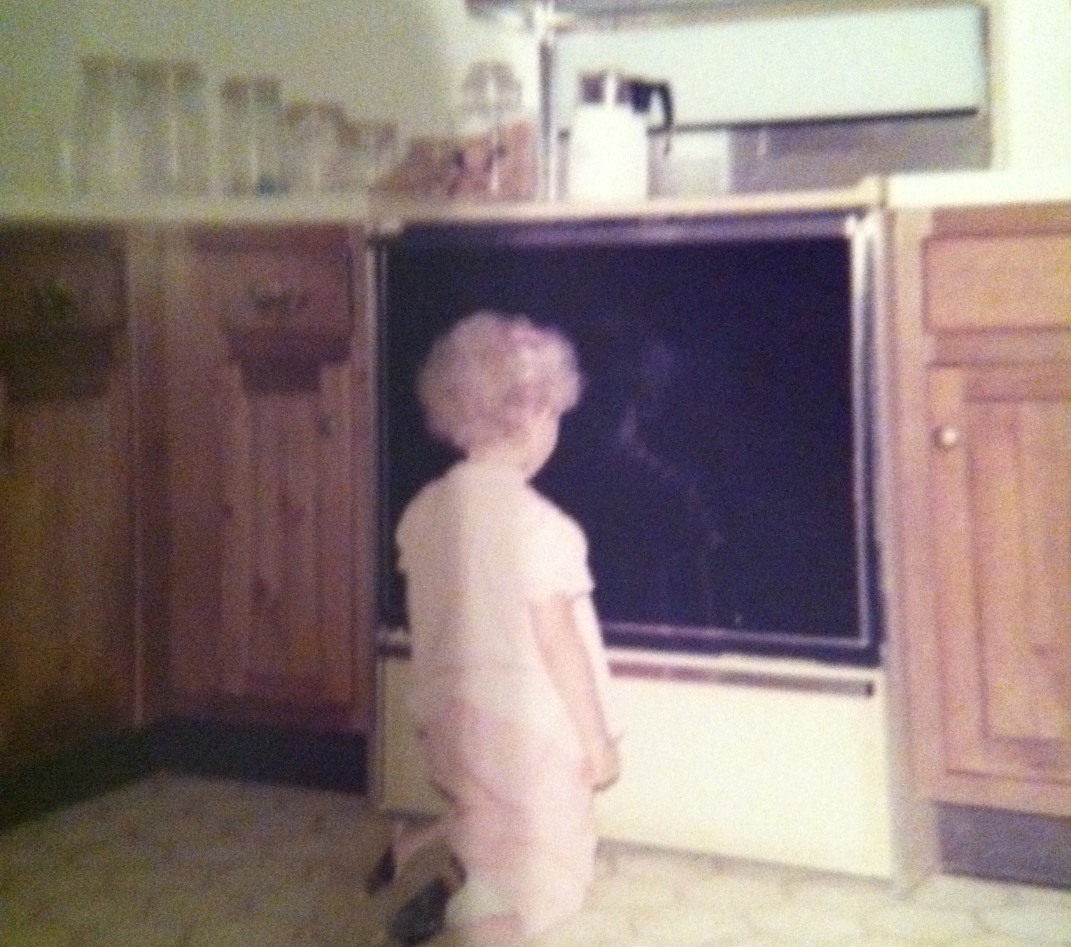 Child looking at oven