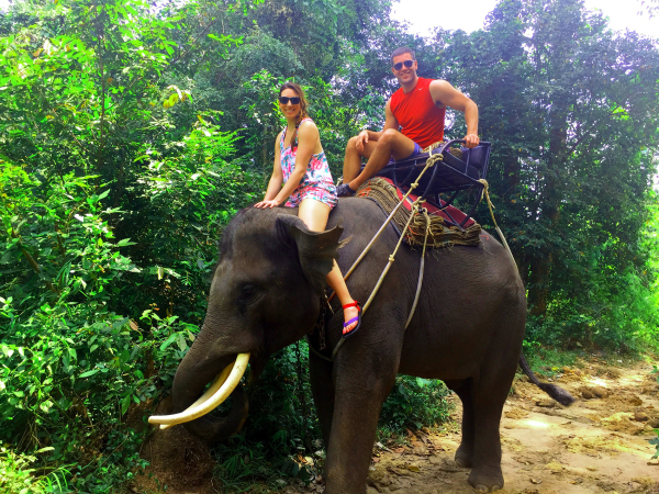 Amanda Giralmo of Wellthie Life on an Elephant