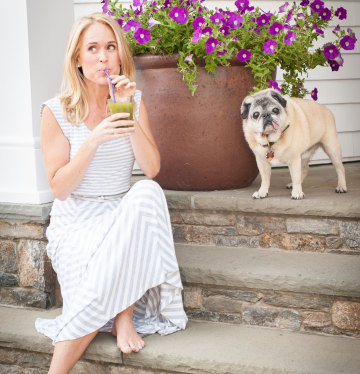 Jenny Lynn of Salt Water Wellness with Her Pet Pug