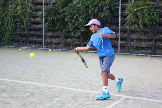 Kid playing tennis at Voyager Tennis Academy