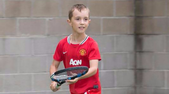 Child playing tennis at Voyager Tennis Academy