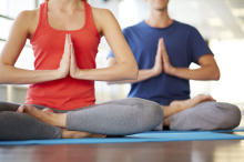 Man and woman in seated yoga pose