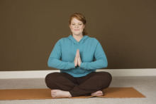 Woman in a seated yoga pose