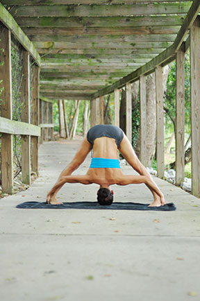 Woman In Yoga Posture On Covered Path