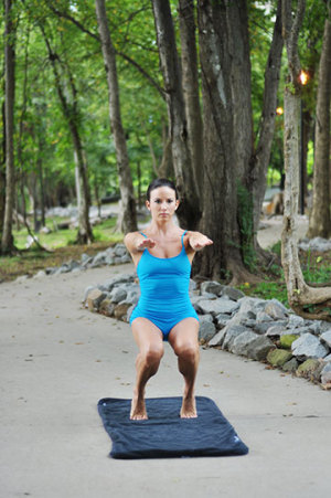 Woman In Yoga Posture In Park