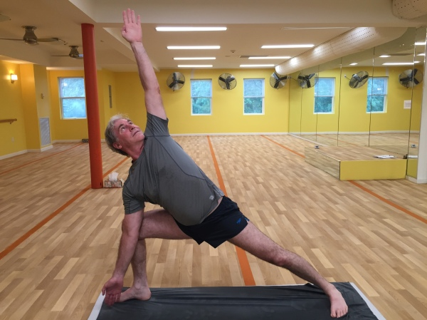 Triangle Pose at Bikram Yoga Roslyn in Roslyn, NY