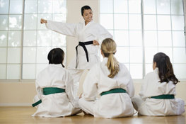 Students Learning From Their Instructor During a Junior Karate Class