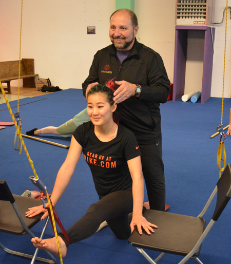 Teacher adjusts head position of student during Physical Limitation Elimination class | Circus Center | San Francisco