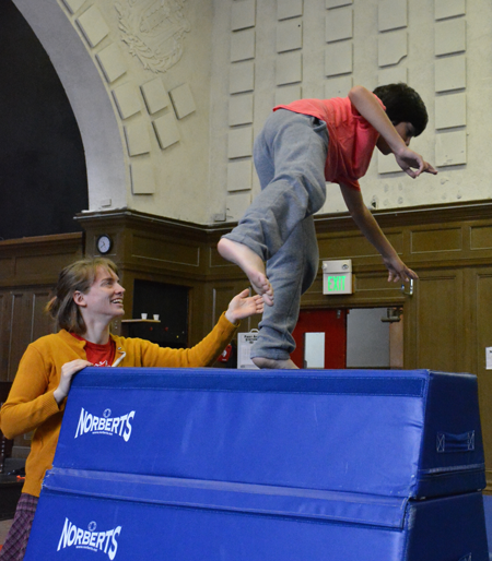 Teacher helps young student through jumping exercise | Circus Center | San Francisco