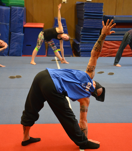Teacher guides students through warm up before a handstand class | Circus Center | San Francisco