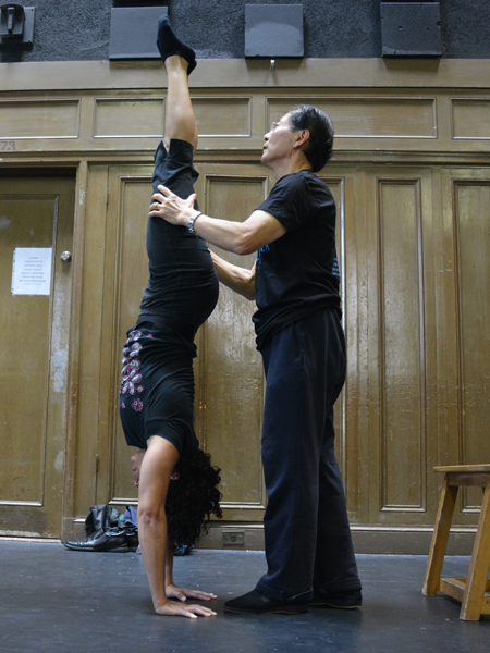 Master teacher Lu Yi corrects a student's position during a handstand | Circus Center | San Francisco