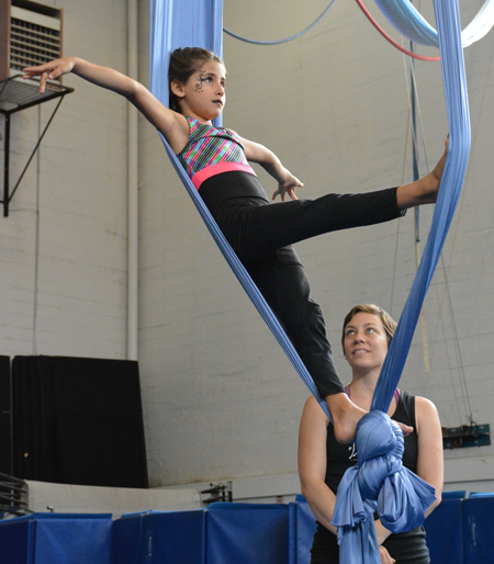 Teachers looks as young circus student performs tissu routine | Circus Center | San Francisco