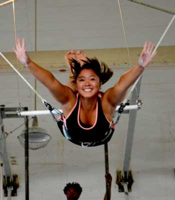 Party guest enjoying the flying trapeze | Corporate Events | Circus Center