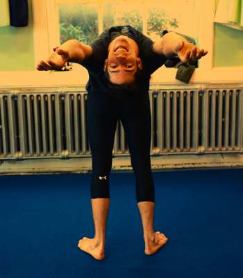 Student bending backwards in the middle of a Stretching class | Circus Center