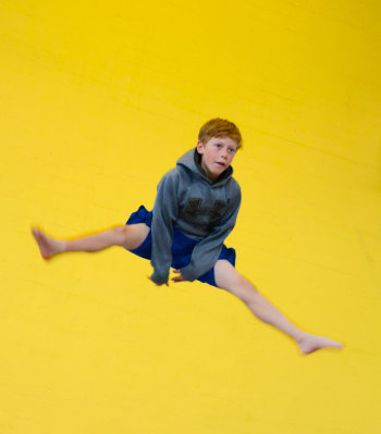 Young person jumping on the trampoline | Kids Parties | Circus Center