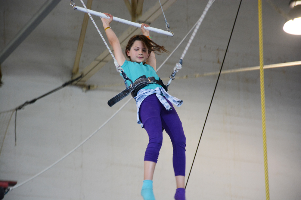 Young person on the flying trapeze | Kids Parties | Circus Center