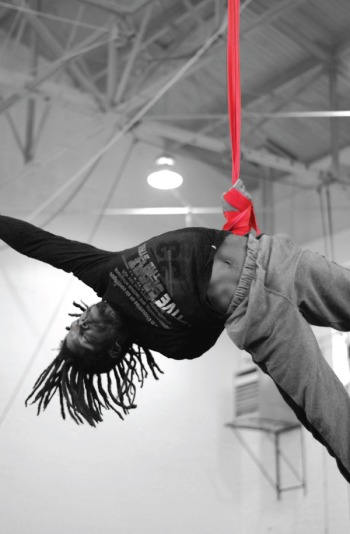 Student training with straps | Circus Center
