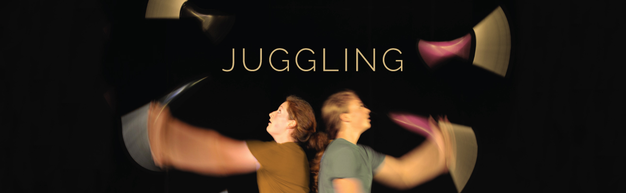 Two performers juggling | Circus Center