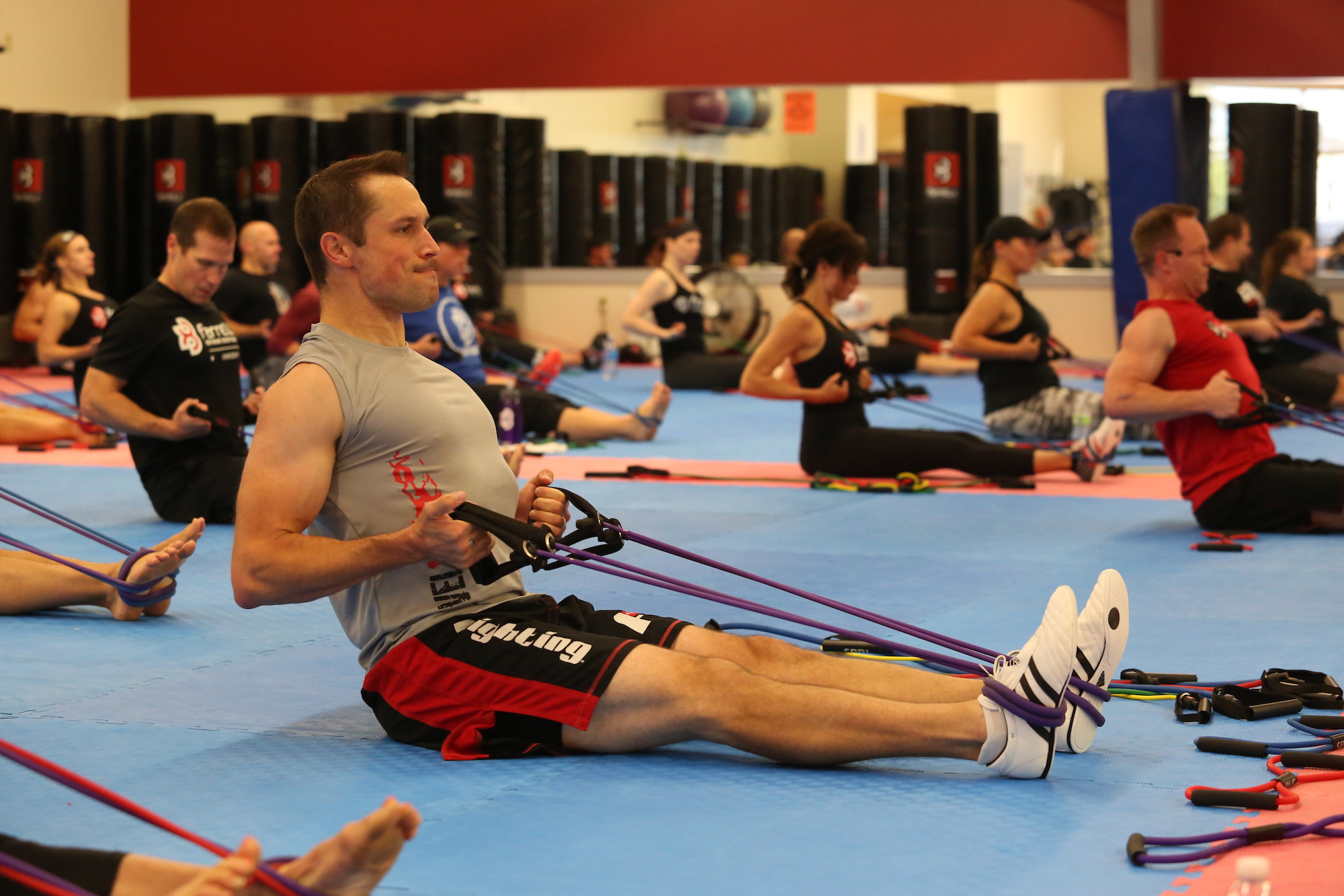 Man Strength Training using resistance bands