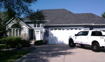 House with a new roof repaif from 1st Team Exteriors