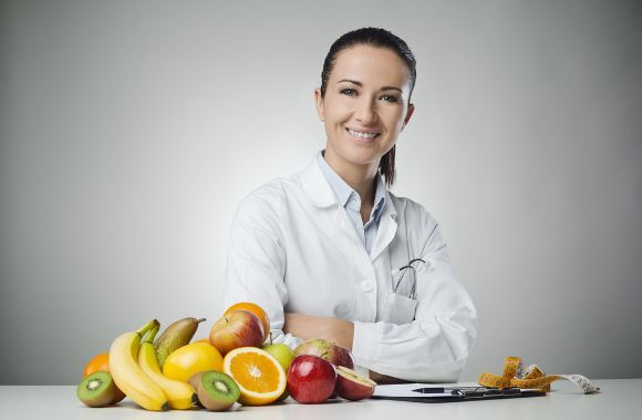 female-nutritionist-with-fruits-and-veggies