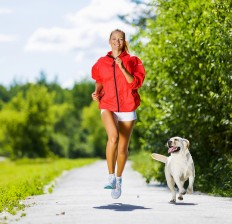 woman-running-with-her-dog-232x224