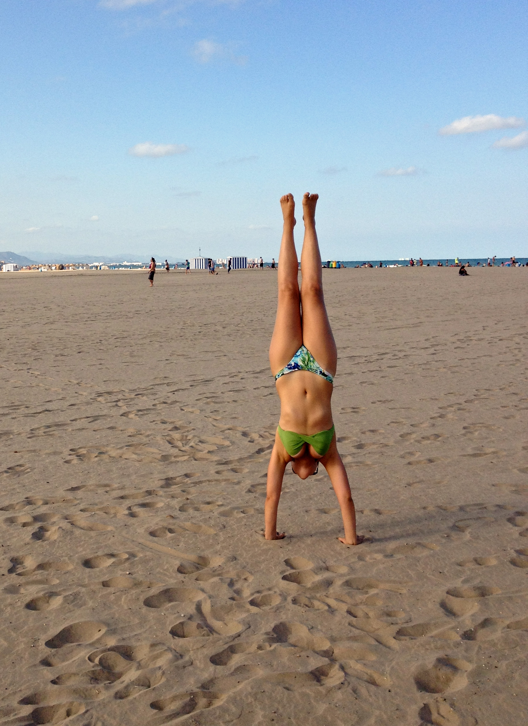Handstand Yoga pose at the beach in Spain, Om Yoga Instructor Maria Lages