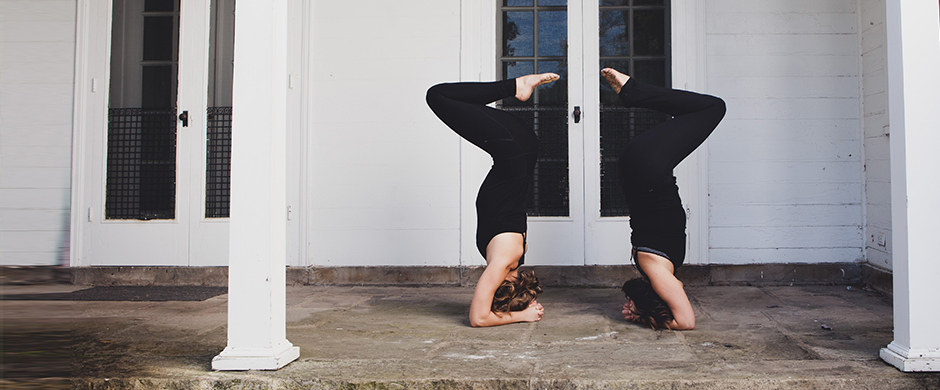 Two Women Posing Upside Down at Release Yoga