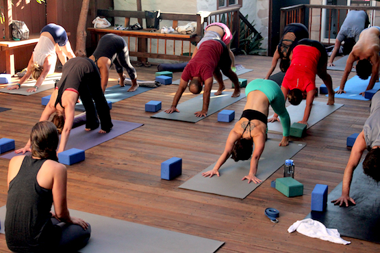 Woman Practicing Yoga on the Outdoor Deck at Riffs Studios in La Jolla, CA