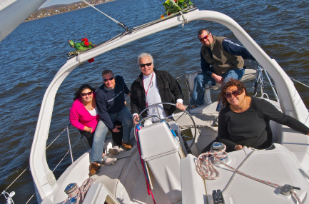 A group practicing leadership skills on a sailboat in Lake Pepin
