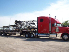 Flatbed red delivery truck