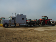SF Advance truck delivering farm equipment