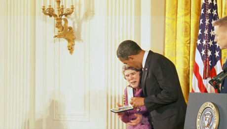 Mary Jo receiving an award from President Obama