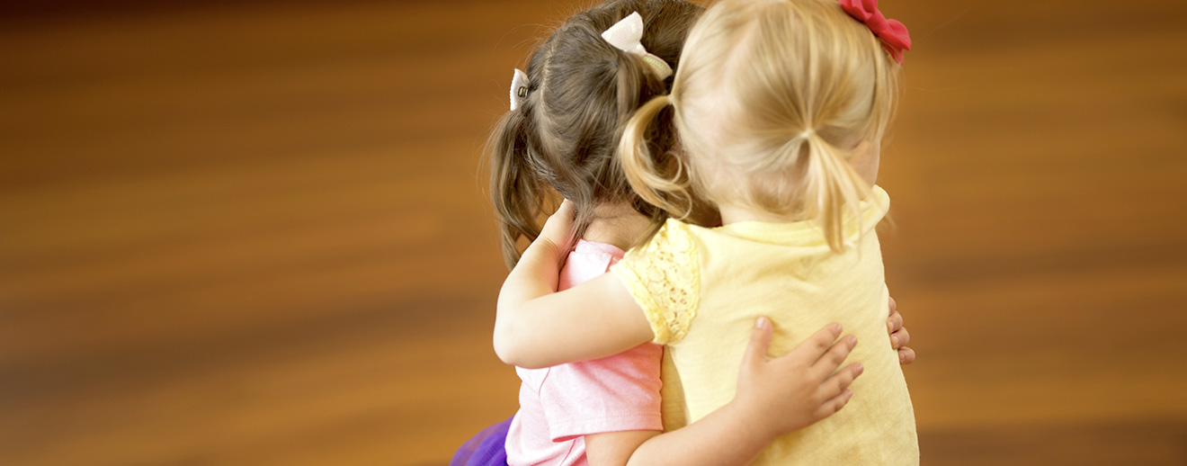 Two Young Girls Hugging at The Little Gym Amsterdam