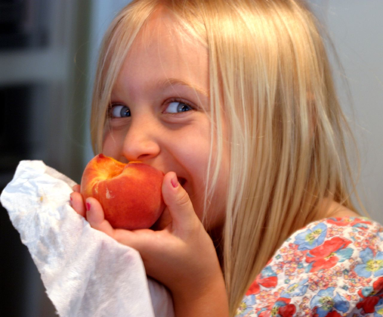 Girl Eating Peach