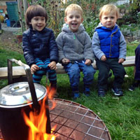 children at minihome nursery enjoy a lovely fire