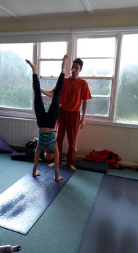 Handstand with support